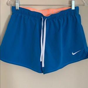 Blue and orange Nike Dri Fit shorts